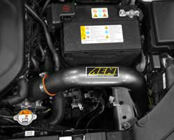 Engine bay shot AEM Cold Air Intake for 2014 Kia Soul models equipped with the 2.0L NU MPI engine