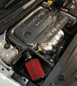 An AEM intake replaces restrictive factory parts with afree-flowing mandrel bent aluminum AEM air intake tube