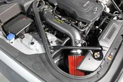 Closeup shot of the AEM 21-796C Cold Air Intake installed on a 2015 Hyundai Genesis Sedan 3.8L