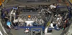Closeup of an AEM 21-800C Cold Air Intake installed on a 2016 Honda HR-V