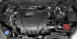 The AEM 21-804C air intake is designed to replace the factory air filter and intake housing.