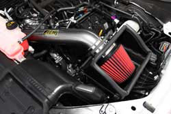 The AEM 2015 Ford F150 5.0L air intake retains the use of the factory cold air inlet near the F150's front grill