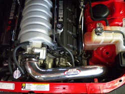 A mandrel bent aluminum AEM cold air intake tube relocates the air filter behind the front bumper for cooler airflow