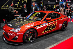 The FRS in the AEM booth at SEMA has a number of aftermarket modificatons to give it a custom look