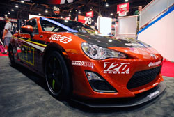 The show vehicle in the AEM SEMA booth started out as a new 2013 Scion FRS