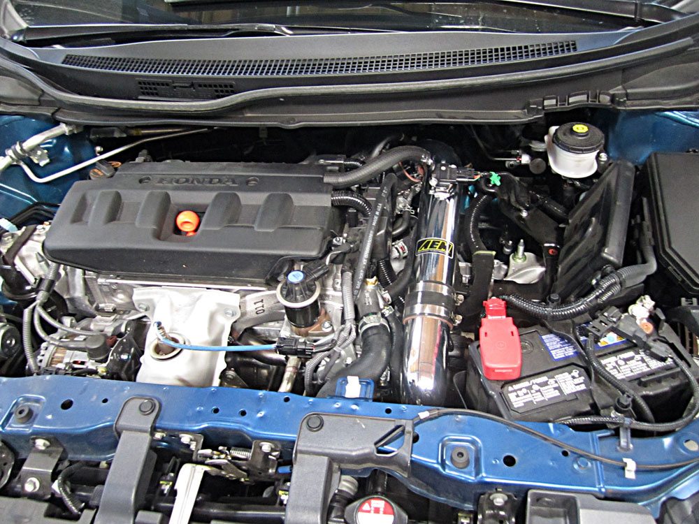 2013 honda civic engine. aem 21-714p cold air intake installed on a 2012, 2013 and 2014 honda civic engine