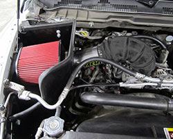 AEM intake 21-8228DP and 21-8228DC use a huge Dryflow Air Filter when compared to the stock filter on the 2013 and 2014 Ram 1500 Hemi models