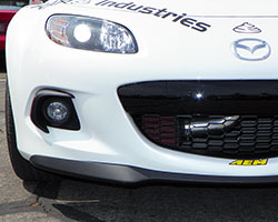 The AEM Cold Air Intake for 2010-2014 Mazda MX-5 Miata 2.0L models places the AEM CAI air filter in front of the radiator