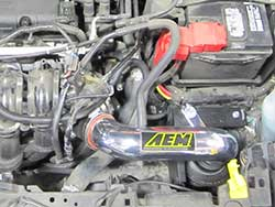 AEM Cold Air Intake 21-731C and 21-731P for the 2014 Ford Fiesta 1.6-liter non-turbo relocates the air filter outside of the engine compartment for cool, fresh, dense air
