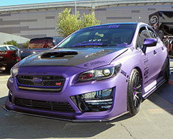 2015 and 2016 Subaru WRX STi shown here in a special purple vinyl wrap attended the 2014 SEMA Show