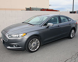 The 2013-2015 Ford Fusion 1.6L EcoBoost turbo engine is a step up from the base naturally aspirated 2.5L Duratec 4-cylinder engine and promises better performance with more MPGs