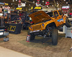 AEM booth's location at the SEMA show afforded the opportunity to highlight new AEM performance parts