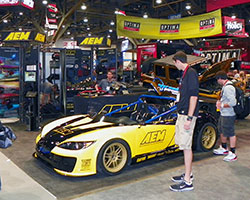 AEM Intakes 2014 SEMA show booth featured two custom vehicles