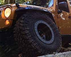 "Mike Kim designed a proprietary Jeep Wrangler JK 2.5"" lift kit with custom wound Eibach coil springs and 11"" travel shocks at all four corners with the ability to fit 37"" tires"