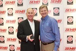 AEM's Kevin Floody receiving the Global Media Award at SEMA.