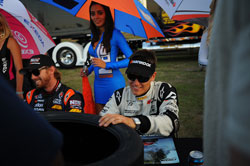 Team driver Fredric Aasbo signing autographs after qualifying.