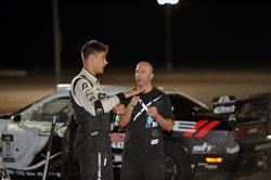 Fredric Aasbo and owner Stephan Papadakis talking tactics between races.