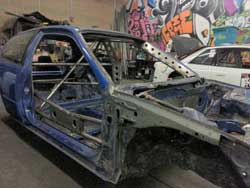The drift-style inspired cage was the first thing Brian Camacho completed on his bare frame Honda