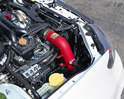An AEM cold air intake, such as the AEM CAI for 2008-2014 Subaru WRX STi models, relocates the air filter with the goal of keeping inlet air temperature (IAT) at or near ambient air temps