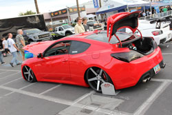 Hydroholics built this red 2011 Hyundai Genesis to display their passion for suspension at SEMA 2012