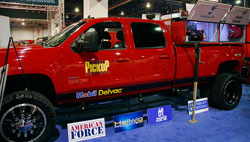 "SEMA Showcased 4x4 GMC Sierra 3500 HD with 4-6"" Adjustable Lift Kit and Electric Winches Mounted on Front and Back Bumpers"