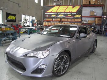 2013 Scion FRS with custom RS style carbon fiber bonnet at AEM for fit check 41-1408.