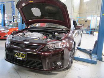2014 Scion TC with AEM 21-725C on the lift for fit check