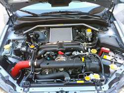 Charlie Wong's custom Subaru Impreza WRX is equipped with an AEM cold air intake and an AEM strut bar.