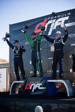 Ryan Tuerck and Tanner Foust hoisting their trophies on the podium in Sonoma.