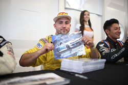 """Jeff Jones' hands-on approach with fans and his """"gangsta"""" style of driving keeps him plenty busy signing autographed photos."""
