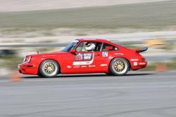 Bright red Optima Ultimate Street car Challenge Porsche 911 at the SEMA show