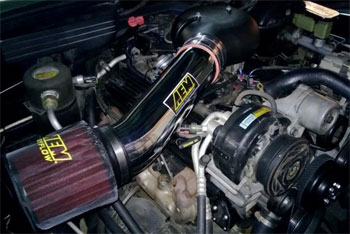 The polished AEM Brute Force Intake System with pre-filter wrap is a big hit at every show Hathaway attends.