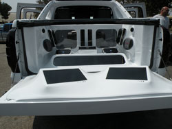 "4 12"" Alpine Type X Subs, 5 Alpine Amplifiers Fiberglassed Into the Bed and 2 15"" TV's Custom Fitted Into the Tailgate"
