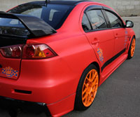 Peter Ruza turned to 3M for matte red door trim and chose CF to supply him with a headliner wrap and door cards.