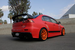 Peter Ruza installed an AEM cold air intake system on his 2008 Mitsubishi Lancer Evo X for improved engine performance.