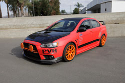 PVR Motorsports' Radiator cover and intake scoop are installed on this 2008 Mitsubishi Lancer Evo X and was on display at SEMA