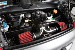 Philip Klotz clamped two AEM performance universal air filters to the end of his custom Porsche 996 GT3 air intake.