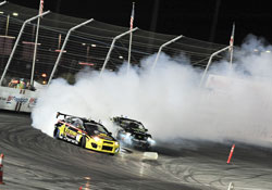 Tanner Foust leading Vaughn Gittin Jr. and throwing up big smoke in Irwindale, CA.