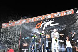 Tanner Foust, Vaughn Gittin Jr, and Michihiro Takatori celebrating atop the podium in Irwindale, CA.