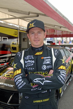Tanner Foust standing in front of his Scion tC after qualifying at FormulaD's Streets of Long Beach event