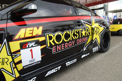 The side of Tanner Foust's TRD V8-powered Scion tC sporting the Number 1 competitor plate for the 2009 FormulaD season
