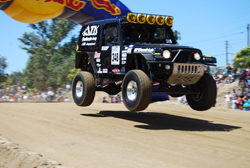 The Jeep Wrangler of Team ATK jumping through an inflatable at the 2009 Baja 500