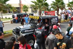 Team ATK parades their JeepSpeed Jeep Wrangler through the streets of Ensenada, Mexico