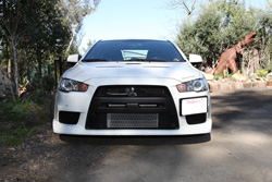 This performance Evo X was set up as a daily driver that wouldn't have to slow down for railroad tracks and could speed up without bottoming out when you landed.