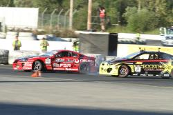 Fredric Aasbo battles Tanner Foust in 2010. Aasbo would join Papadakis Racing for the 2011 season