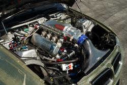 Under the hood of the E92 Eurofighter, which features a custom AEM® Intakes panel filter