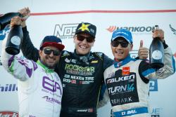 Fredric Aasbo celebrates his event win on the podium with Michael Essa (2nd) and Dai Yoshihara (3rd)