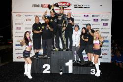 Papadakis Racing team in winners circle at Formula Drift Montreal Photo by Larry Chen/Toyota Racing