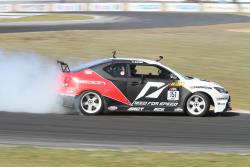 Fredric Aasbo drifts the Papadakis Racing Scion tC2 at Road Atlanta in 2011