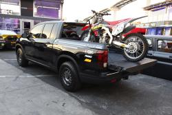 2017 Honda Ridgeline at the 2016 SEMA show with dirt bike in bed